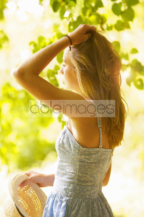 Teenage Girl with Hands on Hair  Outdoors