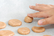 Young boy of 6 bakes cookies only his hand is visible