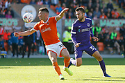 Jordan Thompson of Blackpool  shields the ball from Ben Close of Portsmouth during the EFL Sky Bet League 1 match between Blackpool and Portsmouth at Bloomfield Road, Blackpool, England on 31 August 2019.
