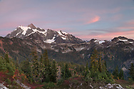 An early October sunset in Washington State's North Cascades Range featuring Mount Shuksan. Photographed from the Huntoon Point on Kulshan Ridge in the Mount Baker Wilderness. <br /> Mount Shuksan itself lies in North Cascades National Park.