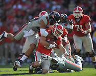 Ole Miss defensive end C.J. Johnson (10) and Ole Miss defensive back Cody Prewitt (25) sacks Georgia quarterback Aaron Murray (11) at Sanford Stadium in Athens, Ga. on Saturday, November 3, 2012.