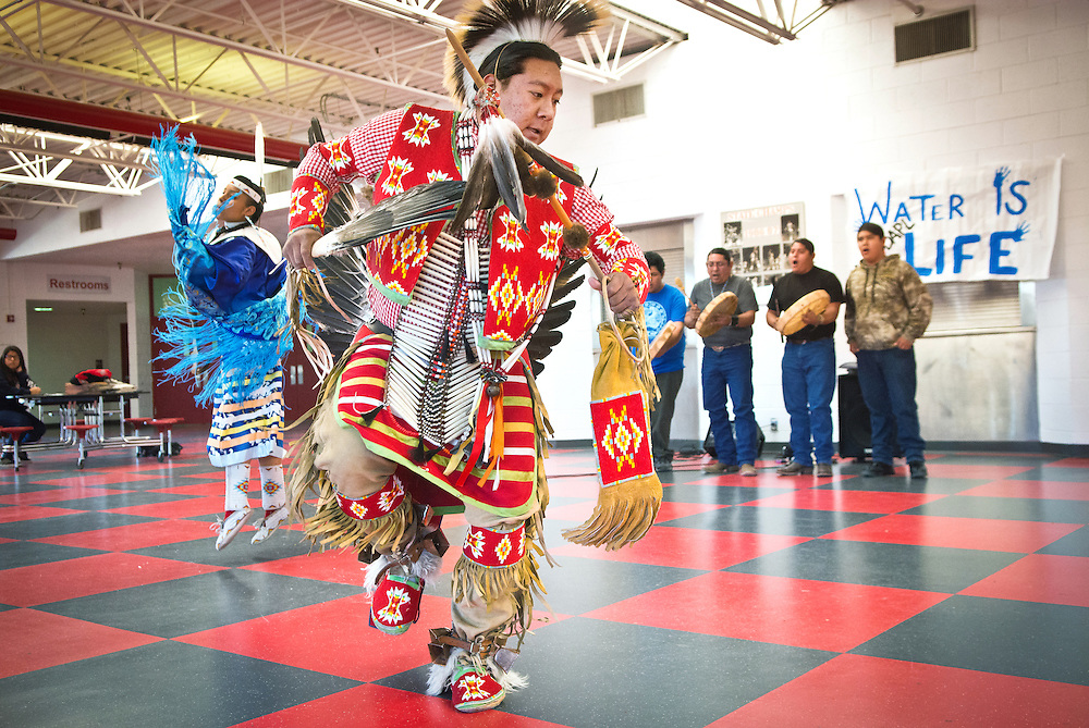 mkb122116/metro/Marla Brose122116<br /> Kaneysa Zhuckkahosee, 17, a Bernalillo High senior, dances during a lunchtime powwow in support of the Dakota Access Pipeline (DAPL) protesters, Wednesday, Dec. 21, 2016, in Bernalillo, N.M. The high school's Hahn Youth Council organized the powwow and a water drive for NoDAPL protesters still at the Oceti Sakowin camp near Standing Rock. (Marla Brose/Albuquerque Journal)