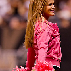 October 3, 2010; New Orleans, LA, USA; A New Orleans Saints Saintsations cheerleader performs on the sideline during a game between the New Orleans Saints and the Carolina Panthers at the Louisiana Superdome. Mandatory Credit: Derick E. Hingle