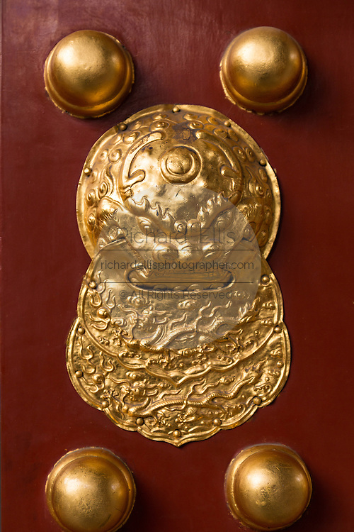 Details on the vermillion door at the Temple of Confucius in Beijing, China