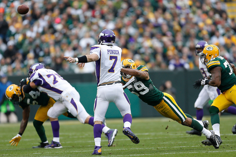 GREEN BAY, WI - DECEMBER 2:  Christian Ponder #7 of the Minnesota Vikings throws a pass while under pressure from Brad Jones #59 of the Green Bay Packers at Lambeau Field on December 2, 2012 in Green Bay, Wisconsin.  The Packers defeated the Vikings 23-14.  (Photo by Wesley Hitt/Getty Images) *** Local Caption *** Christian Ponder; Brad Jones