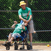 Baseball players at the plate getting a hit during the Norwalk Little League baseball 'Champions' team V Greenwich in the Challenger Division  Recognition Day competition. The day acknowledged the many talents of the great players on the Challenger Division teams. The division has weekly games and practices for kids with special needs. Challenger division are held throughout the country.  Broad River Fields, Norwalk, Connecticut. USA. 2nd June 2013. Photo Tim Clayton