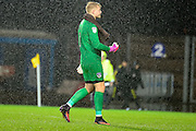 Oldham Athletic goalkeeper (on loan from Middlesborough) Connor Ripley (1) makes a rude gesture to the Oxford United fans at the end of the EFL Sky Bet League 1 match between Oxford United and Oldham Athletic at the Kassam Stadium, Oxford, England on 10 December 2016. Photo by Dennis Goodwin.