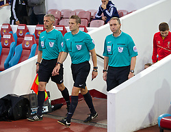 LONDON, ENGLAND - Saturday, September 20, 2014: Referee Craig Pawson leads West Ham United and Liverpool out before the Premier League match at Upton Park. (Pic by David Rawcliffe/Propaganda)