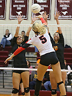 Solon's Meagan Bruene (1) and Kelsey Hinrichs (10) try to block a spike by Maquoketa's Allison Vandemore (5) during the WaMaC Tournament Championship game at Mount Vernon High School in Mount Vernon on Thursday October 11, 2012. Solon defeated Maquoketa 17-25, 25-15, 15-10.