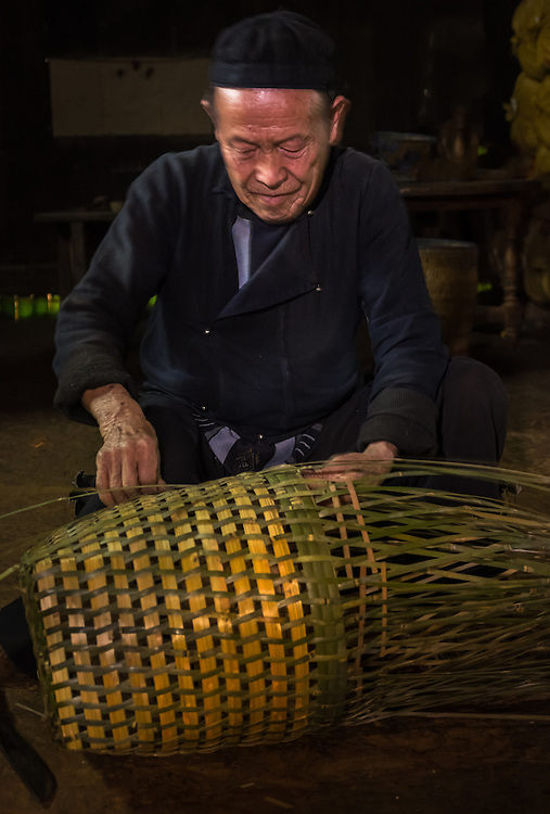 SAPA, VIETNAM - CIRCA SEPTEMBER 2014:  Old man from the Black Hmong minority working on handicrafts in the Ta Phin Village near Sapa, north Vietnam.
