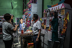September 4, 2017 - Medan, North Sumatra, Indonesia - Ethnic-Chinese Indonesians prepare offerings for the souls of their ancestors during the ''Hungry Ghost Festival'' at Gunung Timur Temple, in Medan on September 4, 2017, North Sumatra, Indonesia. According to the Chinese tradition, the seventh month of the Chinese lunar calendar is called the Ghost Moon where ghosts and spirits are believed to be out of hell to visit the earth during festivals, Chinese give food offerings, ''hell money'' and paper-made models house, to be burned to calm the wandering spirit. (Credit Image: © Ivan Damanik via ZUMA Wire)