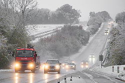 © Licensed to London News Pictures 14/11/2019, Cirencester UK. Snow and rain create hazardous driving conditions on the A417 at Cirencester this morning. Photo Credit : Stephen Shepherd/LNP