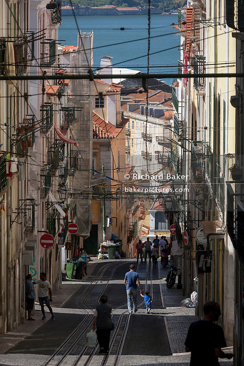 The steep perspective of Rua de Bica de Duarte Belo (Elevador da Bica) in Bairro Alto, Lisbon, Portugal.