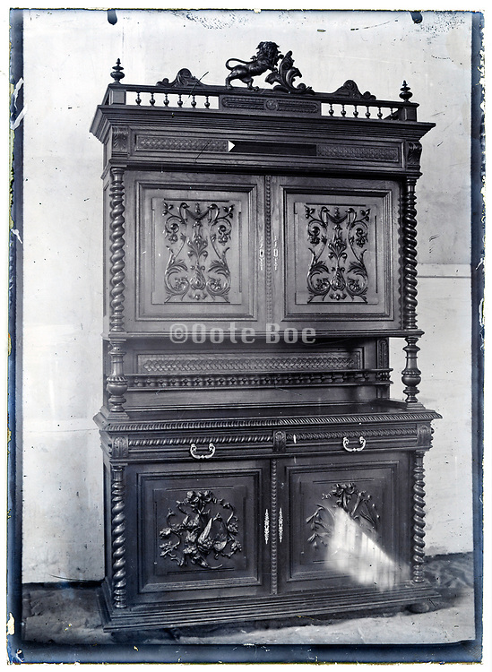 early 1900s product photo of ornamental cabinet closet