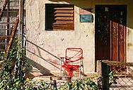 Porch with old chair in Santa Fe, Havana, Cuba.