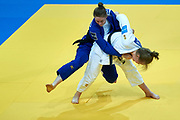 Warsaw, Poland - 2017 April 21: Sannevan Dijke from Netherlands (white) competes with Giovanna Scoccimarro from Germany (blue) in the women&rsquo;s 70kg final during European Judo Championships 2017 at Torwar Hall on April 21, 2017 in Warsaw, Poland.<br /> <br /> Mandatory credit:<br /> Photo by &copy; Adam Nurkiewicz / Mediasport<br /> <br /> Adam Nurkiewicz declares that he has no rights to the image of people at the photographs of his authorship.<br /> <br /> Picture also available in RAW (NEF) or TIFF format on special request.<br /> <br /> Any editorial, commercial or promotional use requires written permission from the author of image.