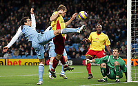Photo: Paul Thomas.<br /> Manchester City v Watford. The Barclays Premiership. 04/12/2006.<br /> <br /> Bernardo Corradi of Man City (L) shoots for goal after a saved shot by Watford keeper Richard Lee (Green) from Joey Barton's free kick.