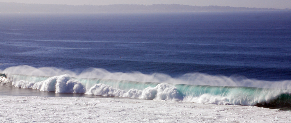 Large winter swells push large waves crashing to shore.
