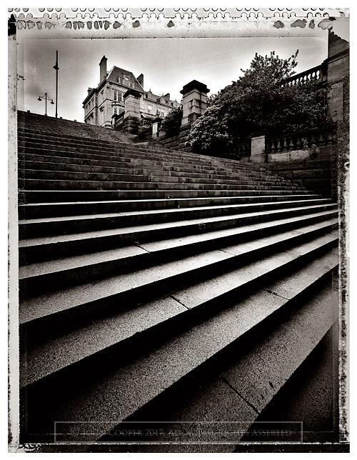 Black and white photograph of steps beside  Kelvingrove Park in Glasgow. Mounted print available to purchase in various sizes.