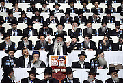 Rabbi Daniel Zar speaks at the Shas Party's rally, as he is surrounded by the Party's spiritual leaders, in Tel Aviv, March 3, 2015. Some 10,000 supporters of the Ultra-Orthodox Shas Party gathered on the Nokia Stadium in Tel Aviv for the party's election campaign largest rally. Photo by Gili Yaari
