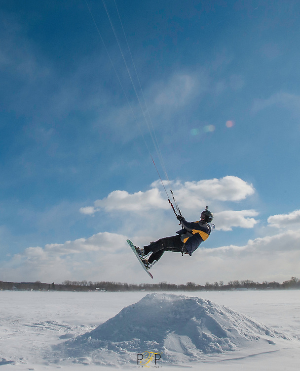 Sturgeon Spectacular, Winnebago Ice festival. Ice kite, snowboard,kite fly, dance,bar, party. February 12, 2016,Patrick Flood Photography llc.
