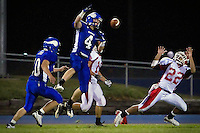 Coeur d'Alene High's Jake Matheson spot the ball in the air before making the interception in front of an awaiting Anthony Gold from Sandpoint High.