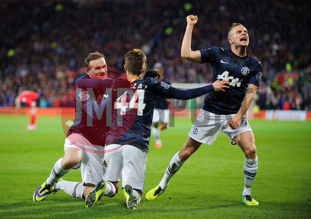 Man Utd Forward Wayne Rooney (ENG) celebrates with Midfielder Adnan Januzaj (BEL) after scoring a goal during the first half of the match - Photo mandatory by-line: Rogan Thomson/JMP - Tel: Mobile: 07966 386802 - 24/11/2013 - SPORT - FOOTBALL - Cardiff City Stadium - Cardiff City v Manchester United - Barclays Premier League.