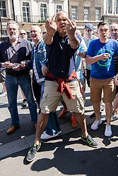 """© Licensed to London News Pictures . 06/05/2018. London, UK. Far right protesters confront anti fascists on Whitehall . Supporters of alt-right and anti-Islam groups, including Generation Identity and the Democratic Football Lads Alliance, demonstrate at Whitehall in Westminster, opposed by anti-fascists. Speakers billed in the """"Day for Freedom"""" include former EDL leader Tommy Robinson, Milo Yiannopoulos, youtuber Count Dankula (Markus Meechan), For Britain leader Anne Marie Waters, UKIP leader Gerard Batten, Breitbart's Raheem Kassam and Lauren Southern. The event was originally planned as a march to Twitter's HQ in protest at their banning of Robinson and the Home Office's ban on Martin Sellner and Brittany Pettibone entering the UK, in what protesters describe as limits being imposed on free speech. Photo credit: Joel Goodman/LNP"""