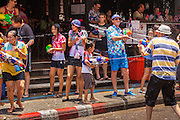 13 APRIL 2013 - BANGKOK, THAILAND:   Thais and tourists in a water fight on Soi Nana, off of Sukhumvit Road in Bangkok. Songkran is celebrated in Thailand as the traditional New Year's Day from 13 to 16 April. The date of the festival was originally set by astrological calculation, but it is now fixed. If the days fall on a weekend, the missed days are taken on the weekdays immediately following. Songkran is in the hottest time of the year in Thailand, at the end of the dry season and provides an excuse for people to cool off in friendly water fights that take place throughout the country. Songkran has been a national holiday since 1940, when Thailand moved the first day of the year to January 1.  PHOTO BY JACK KURTZ