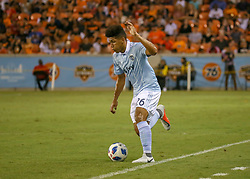 July 18, 2018 - Houston, TX, U.S. - HOUSTON, TX - JULY 18:  Sporting Kansas City defender Jaylin Lindsey (26) sends the ball during the US Open Cup Quarterfinal soccer match between Sporting KC and Houston Dynamo on July 18, 2018 at BBVA Compass Stadium in Houston, Texas. (Photo by Leslie Plaza Johnson/Icon Sportswire) (Credit Image: © Leslie Plaza Johnson/Icon SMI via ZUMA Press)