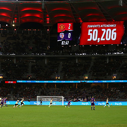 The official attendance of 50,206 is shown on the big screen