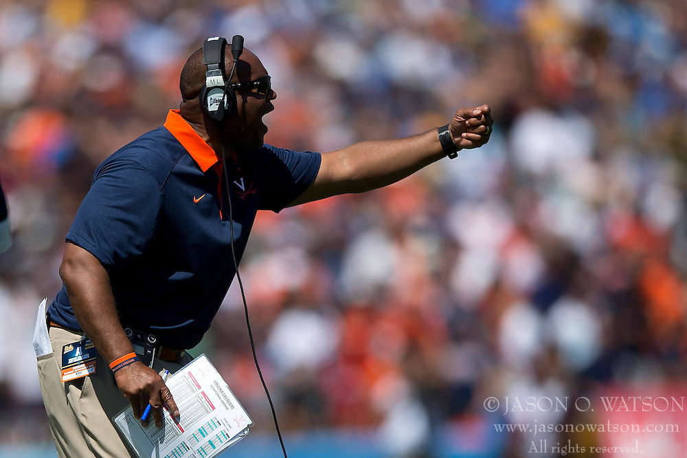 PASADENA, CA - SEPTEMBER 05:  Head coach Mike London of the Virginia Cavaliers directs his team on the sidelines during the second quarter against the UCLA Bruins at the Rose Bowl on September 5, 2015 in Pasadena, California. The UCLA Bruins defeated the Virginia Cavaliers 34-16. (Photo by Jason O. Watson/Getty Images) *** Local Caption *** Mike London