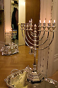 Chanukah lasts for 8 days and is the Jewish festival of light. It commemorates the rededication of the temple after it had been defiled. A candle is lit every night. In order to bring light to the world some put the candles in their front windows.  Here on the 5th day of Chanukah menorahs are placed the doorways of a local household.