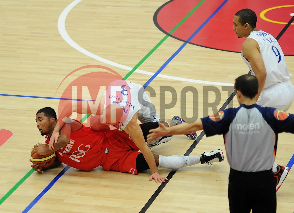 Bristol Flyers' Dwayne Lautier-Ogunleye is challenged for the ball - Photo mandatory by-line: Dougie Allward/JMP - Mobile: 07966 386802 - 15/11/14 - SPORT - Basketball - Bristol - SGS Wise Campus - Bristol Flyers v Cheshire Phoenix - British Basketball League
