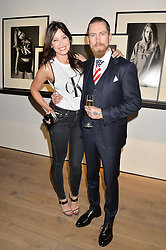 DAISY LOWE and JUSTIN O'SHEA Director of Mytheresa.com at the Calvin Klein Jeans X mytheresa.com launch the Re-Issue Project at 37 Rathbone Street, London on 17th July 2014.