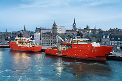 Early morning view of Aberdeen port with North Sea oil industry offshore support vessels moored, Aberdeenshire, Scotland, UK