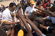 MLB Hall of Famer Dave Winfield (left) is surrounded by children as he distributes t-shirts after an exhibition baseball game in the city of Tema, roughly 35 km east of Ghana's capital Accra on Saturday February 3, 2007. The game was being held on the occasion of the visit of a delegation from the American Major League Baseball Association made possible by the African Development Foundation, a non-profit organization that supports little league projects in selected African countries.