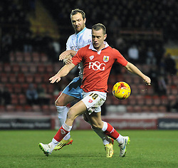 Bristol City's Aaron Wilbraham controls the ball under pressure from Coventry City's Andy Webster - Photo mandatory by-line: Dougie Allward/JMP - Mobile: 07966 386802 - 10/12/2014 - SPORT - Football - Bristol - Ashton Gate Stadium - Bristol City v Coventry City - Johnstone's Paint Trophy