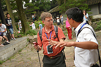 CALS plant biology professor Dr. Tom Wentworth (left) asks his tour guide about a building at the Humble Administrator's Garden in Suzhou.