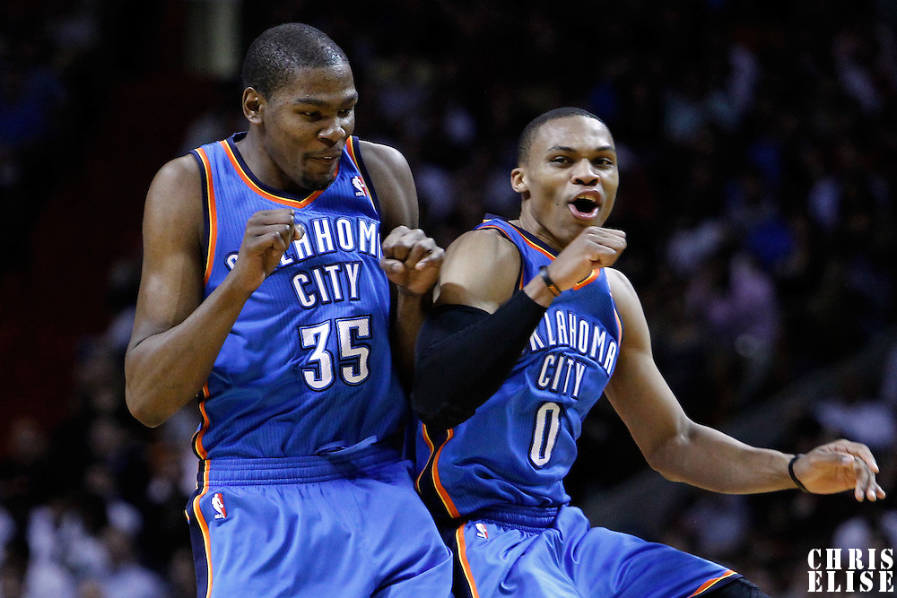 16 March 2011: Oklahoma City Thunder small forward Kevin Durant (35) celebrates with Oklahoma City Thunder point guard Russell Westbrook (0) during the Oklahoma City Thunder 96-85 victory over the Miami Heat at the AmericanAirlines Arena, Miami, Florida, USA.