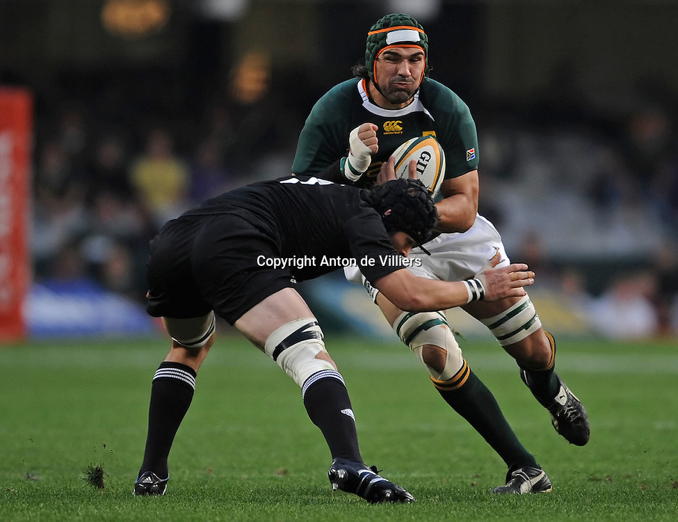 Victor Matfield of the Springboks on the attack with Richie McCaw (c) of the All Blacks making the tackle.<br /> Rugby - Tri-Nations - 090801 - South Africa v New Zealand - ABSA Stadium - Durban - South Africa. The Springboks won 31-19.<br /> Photographer : Anton de Villiers / SASPA