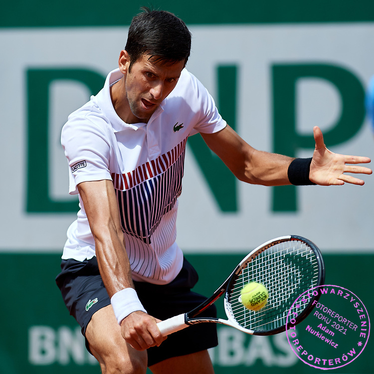 Paris, France - 2017 May 31: Novak Djokovic from Serbia plays a backhand while his men's single match second round during tennis Grand Slam tournament The French Open 2017 (also called Roland Garros) at Stade Roland Garros on May 31, 2017 in Paris, France.<br /> <br /> Mandatory credit:<br /> Photo by &copy; Adam Nurkiewicz<br /> <br /> Adam Nurkiewicz declares that he has no rights to the image of people at the photographs of his authorship.<br /> <br /> Picture also available in RAW (NEF) or TIFF format on special request.<br /> <br /> Any editorial, commercial or promotional use requires written permission from the author of image.