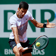 Paris, France - 2017 May 31: Novak Djokovic from Serbia plays a backhand while his men's single match second round during tennis Grand Slam tournament The French Open 2017 (also called Roland Garros) at Stade Roland Garros on May 31, 2017 in Paris, France.<br /> <br /> Mandatory credit:<br /> Photo by © Adam Nurkiewicz<br /> <br /> Adam Nurkiewicz declares that he has no rights to the image of people at the photographs of his authorship.<br /> <br /> Picture also available in RAW (NEF) or TIFF format on special request.<br /> <br /> Any editorial, commercial or promotional use requires written permission from the author of image.