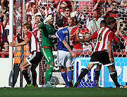 James Tarkowski scoring Brentfords equiliser in a goal mouth scramble, Bartosz Bialkowski thinking he was fouled during the Sky Bet Championship match between Brentford and Ipswich Town at Griffin Park, London, England on 8 August 2015. Photo by Matthew Redman.