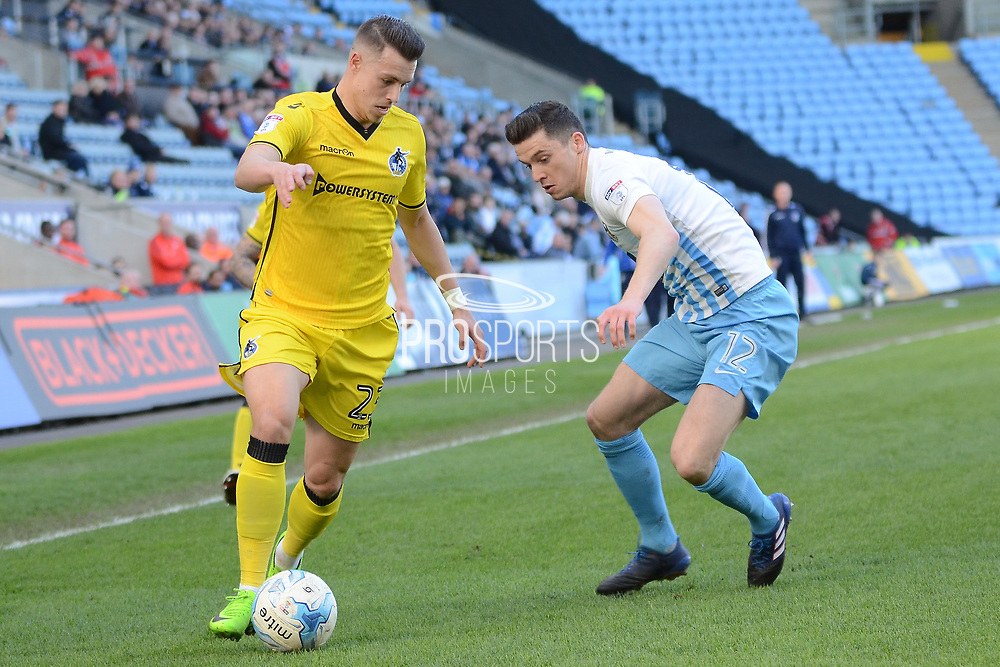 Bristol Rovers midfielder Billy Bodin (23) takes on Coventry City midfielder Callum Reilly (12) 0-0 during the EFL Sky Bet League 1 match between Coventry City and Bristol Rovers at the Ricoh Arena, Coventry, England on 25 March 2017. Photo by Alan Franklin.