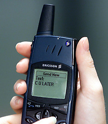Texting on a mobile phone from the year 2000, September 5, 2000. Photo by Andrew Parsons/i-Images..