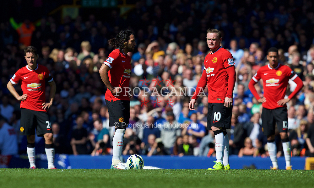LIVERPOOL, ENGLAND - Sunday, April 26, 2015: Manchester United's Wayne Rooney looks dejected as Everton score the third goalo during the Premier League match at Goodison Park. (Pic by David Rawcliffe/Propaganda)