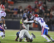 Ole Miss' Tobias Singleton (7) is tackled by Louisiana Tech's Dave Clark (24) in Oxford, Miss. on Saturday, November 12, 2011.