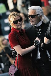Kirsten Dunst and Karl Lagerfeld attend the Chanel Spring-Summer 2008 Ready-to-Wear collection presentation held at the Grand Palais in Paris, France, on October 5, 2007. Photo by Khayat-Nebinger-Orban-Taamallah/ABACAPRESS.COM