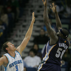Jan 20, 2010; New Orleans, LA, USA; Memphis Grizzlies forward Zach Randolph (50) shoots over New Orleans Hornets forward Darius Songaila (9) during the second half at the New Orleans Arena. The Hornets defeated the Grizzlies 113-111. Mandatory Credit: Derick E. Hingle-US PRESSWIRE